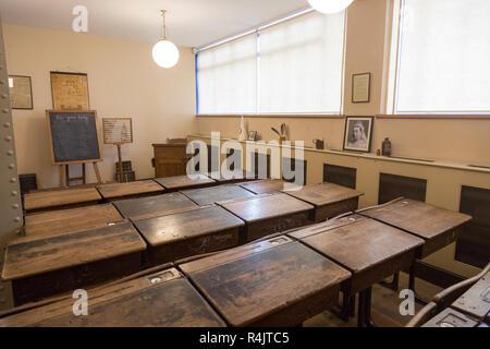 Wooden desks in school classroom from early 1900s, Radstock museum, Somerset, England, UK - Stock Image