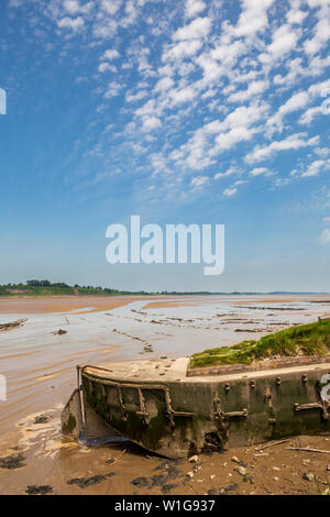 Beached Ferrocement Barges on the banks of the River Severn, part of the Purton Hulks, Gloucestershire, England - Stock Image
