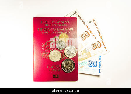 Passport from Bulgaria with money and coins on white background - Stock Image