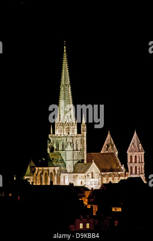 Night view of Saint Nazaire Cathedral Autun Burgundy France with gothic spire seen from Rue de Planoises with floodlights - Stock Image