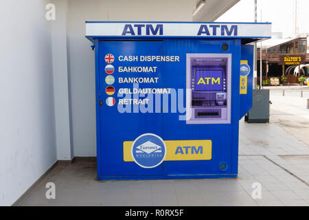 ATM machine with multilingual instructions, Agia Napa, Cyprus October 2018 - Stock Image