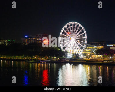 Brisbane Wheel With Its Lights On At Night Time - Stock Image