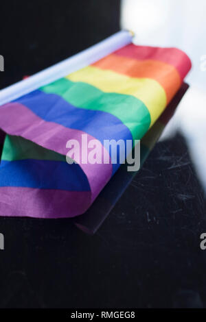 Gay lesbian LGBT rights homosexual pride flag with rainbow mutlicolor design. - Stock Image