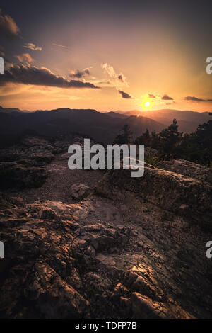 rock on the mountain top at sunset in the austrian alps - Stock Image