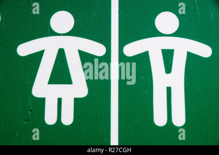 Public restroom toilet WC sign man and woman in green - Stock Image
