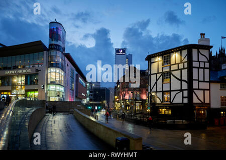 Designer department store Harvey Nichols and rebuilt Old Wellington Inn and Sinclair's Oyster Bar at Exchange Square, Shambles Square,  Manchester cit - Stock Image