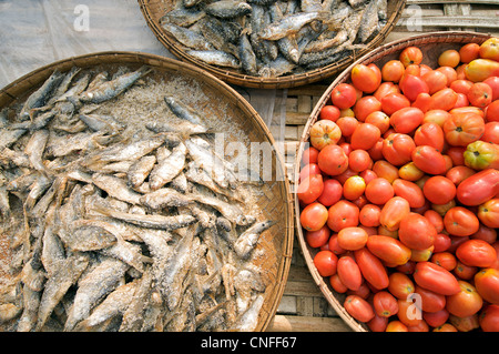 Dried fish and tomatoes for sale at Hsipaw market, Shan State, Burma - Stock Image