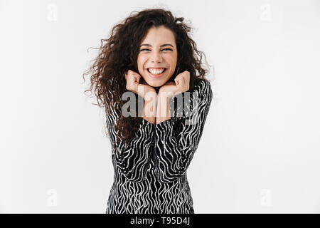Portrait of a cheerful attractive woman wearing bright clothes and makeup standing isolated over white background, posing - Stock Image