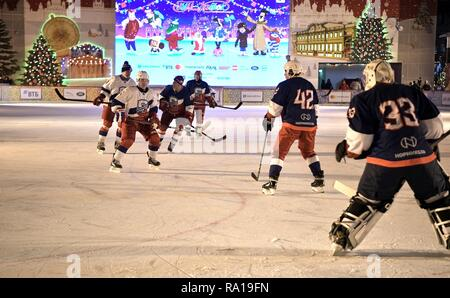 Moscow, Russia. 29th December 2018. Russian President Vladimir Putin #11, left, during ice hockey action at the Night Hockey League match in the rink at the GUM Department store in Red Square December 29, 2018 in Moscow, Russia. Credit: Planetpix/Alamy Live News - Stock Image