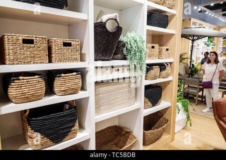Miami Florida Midtown The Shops at Midtown Miami shopping West Elm home retailer store business inside display sale baskets home decor - Stock Image