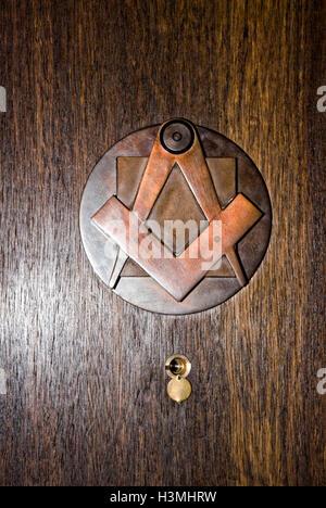 brass door knocker masonic symbols compass  square inside a masonic lodge freemason freemasonry freemason secret - Stock Image