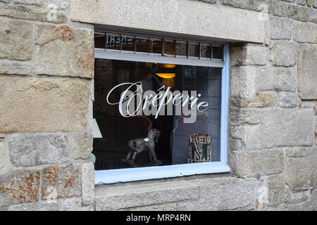 A creperie window in a historic stone building in Brittany, France. - Stock Image