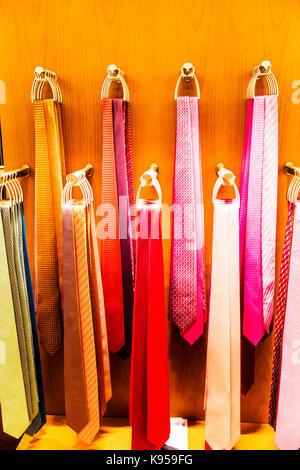 Display of ties, tie display, tie rack display, tie rack, pink ties, mens ties, tie shop display, tie store display, - Stock Image