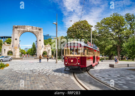 3 January 2019: Christchurch, New Zealand - A vintage tram turns into Cashel Street near the Bridge of Remembrance in the centre of Christchurch. - Stock Image