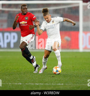 Optus Stadium, Burswood, Perth, W Australia. 17th July 2019. Manchester United versus Leeds United; pre-season tour; Kalvin Phillips of Leeds United moves the ball forward challenged by Paul Pogba of Manchester United Credit: Action Plus Sports Images/Alamy Live News - Stock Image