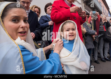 Tenerife, Canary Islands, a mother adjusts her daughter's scarf during the Palm Sunday Holy Week procession through the streets of La Laguna. - Stock Image