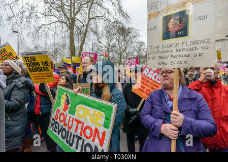 London, UK. 16th March 2019. A woman in the crowd holds a placard for black nurse Mary Seacole. Thousands march through London on UN Anti-Racism day to say 'No to Racism, No to Fascism' and that 'Refugees Are Welcome Here', to show solidarity with the victims of racist attacks including yesterdays Christchurch mosque attack and to oppose Islamophobic hate crimes and racist policies in the UK and elsewhere. The marchers met in Park Lane where there were a number of speeches before marching to a rally in Whitehall. Marches took place in other cities around the world including Glasgow and Cardiff - Stock Image