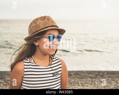 Ten years old girl at the beach - Stock Image