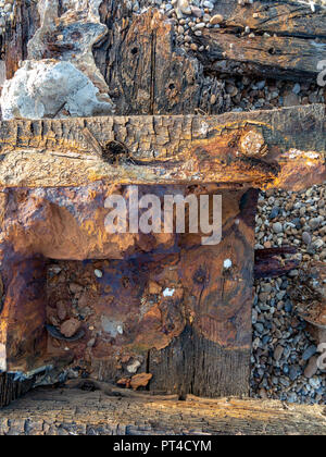 Details of marine wreckage showing colours and textures created by rust and distressing - Stock Image