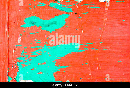 Red and green paint on a wooden surface as an abstract - Stock Image