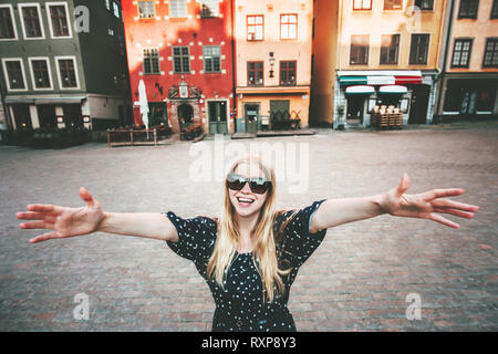 Happy smiling woman walking in Stockholm travel sightseeing fashion lifestyle summer vacations in Sweden - Stock Image