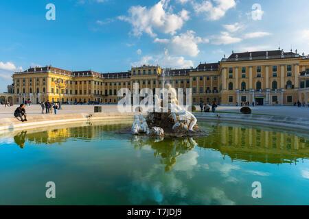 Schonbrunn Austria, view of a baroque fountain sited in the grand courtyard of the Schloss Schönbrunn palace in Vienna, Austria. - Stock Image