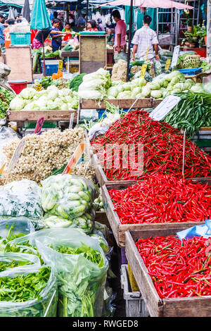 Bangkok, Thailand - 6th September 2009: Market stall with vegetables and red chillies, Khlong Toei market. The market is the largest wet market in the - Stock Image
