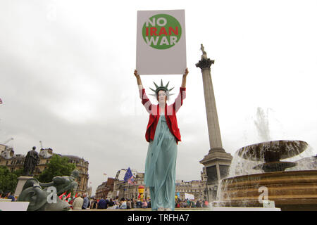 A woman holding a ÒNo Iran WarÓ sign During a protest which coincides with Donald TrumpÕs state visit to the United Kingdom on 04/06/2019 - Stock Image