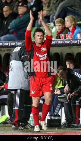 Leverkusen winger Bernd Schneider cheers to the fans when being substituted from the UEFA Cup group E match Bayer - Stock Image