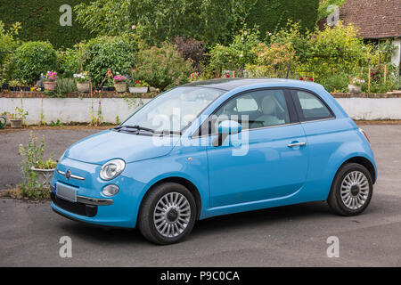Side view of Fiat 500 mini car in UK with identification number plate partly obscured for security reasons - Stock Image