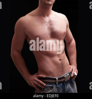Close up portrait of shirtless handsome man, black background - Stock Image