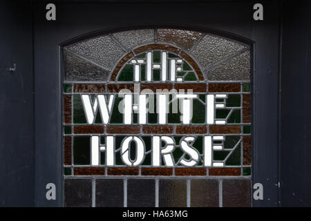 Stained glass window on the door of The White Horse at Neatishead, Norfolk Broads - Stock Image