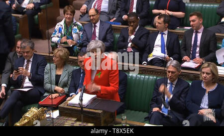 Prime Minister Theresa May speaks during Prime Minister's Questions in the House of Commons, London. - Stock Image