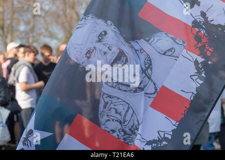 Braintree, Essex, UK. 29th Mar 2019.  Funeral of Prodigy frontman Keith Flint at St Mary's Church in Bocking attended by hundreds of his fans A Keith Flint flag, Credit: Ian Davidson/Alamy Live News - Stock Image