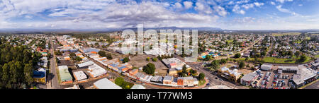 Roof tops streets and houses of Hunter valley town Cessnock. Wine making region in NSW, Australia - wide panoramic aerial view. - Stock Image