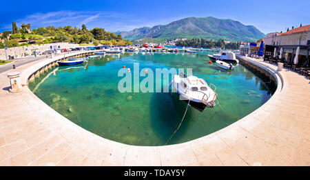 Colorful turquoise harbor in town of Cavtat panoramic view, southern Dalmatia coastline of Croatia - Stock Image