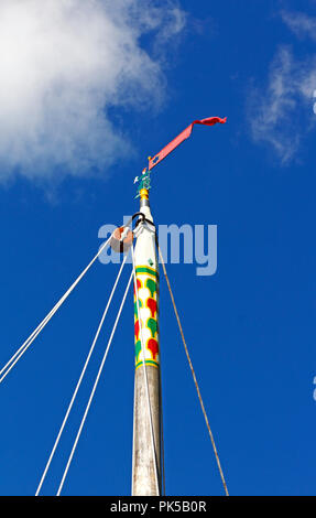 A view of the masthead of the Norfolk Pleasure Wherry Hathor moored on the River Ant by How Hill, Ludham, Norfolk, England, United Kingdom, Europe. - Stock Image