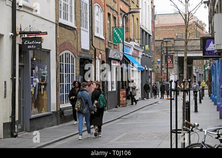 People walking along Rivington Street past boutique shops in Shoreditch East London UK  KATHY DEWITT - Stock Image