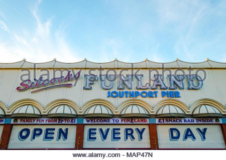 Slicocks Funland on Southport Pier the family run amusement arcade which is open every day, photo of the exterior showing it closed, close to 6 pm - Stock Image