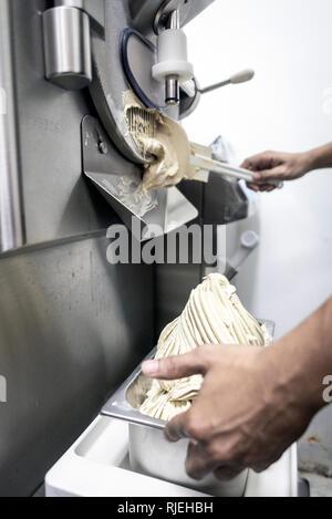 making gelato ice cream with modern professional equipment preparation detail in kitchen interior - Stock Image