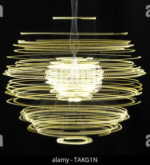 Spinning light trails - Stock Image