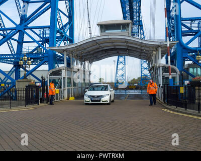 Transporter Bridge cars leaving the bridge after crossing to Middlesbrough from Port Clarence on the North bank of the Tees - Stock Image
