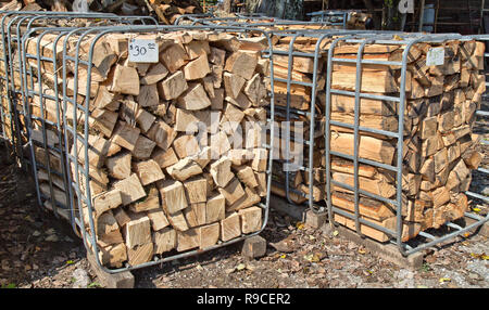 Split firewood, open-end bins with pricetags, firewood opertion & sales yard. - Stock Image