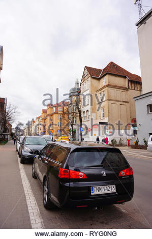 Poznan, Poland - March 8, 2019: Parked black Honda Accord car by a sidewalk on the Slowackiego street in the city center. - Stock Image
