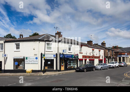 Allerton Road Woolton Liverpool, featuring Wooltonifa Oakley Independent Ltd. Financial Advisors and the King Do Chinese restaurant. - Stock Image