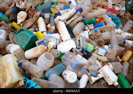 Ocean pollution: plastic bottles and containers washed up on a beach of the island of Amorgos, Greece. - Stock Image