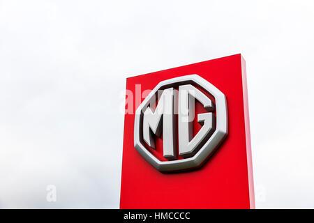 MG car dealers dealer dealership sign car sales car dealer emblem UK England - Stock Image