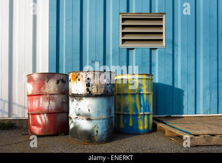 colorful industrial 55 gallon drums - Stock Image