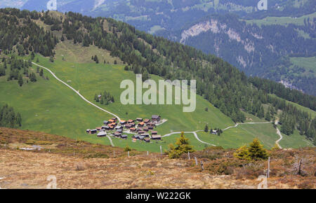 View of the village Obermutten. Early summer in the Swiss Alps. - Stock Image