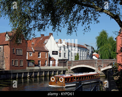 Sightseeing Tourist Boat on The River Wensum in the Center of The Historic City of Norwich, Norfolk, England, UK - Stock Image